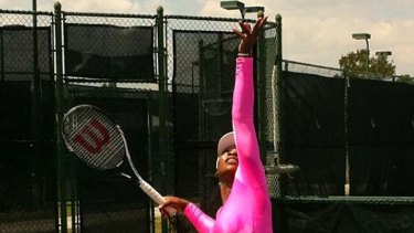 Hot pink . . . Serena Williams is back on the court.