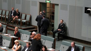 A group of Coalition MPs walk out of the chamber while Opposition Leader Bill Shorten raised the budget in his Closing the Gap speech.