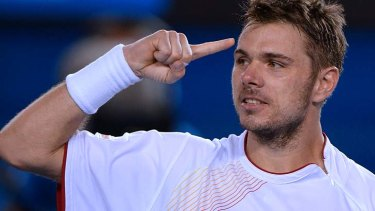 Stanislas Wawrinka gestures as he celebrates after defeating Novak Djokovic on Tuesday night.