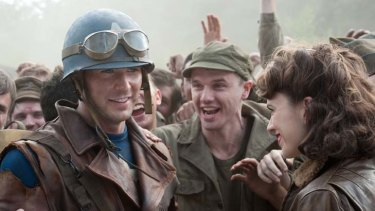 Unlikely hero ... Steve Rogers (Chris Evans) is greeted by Peggy Carter (Hayley Atwell) in <i>Captain America</i>.