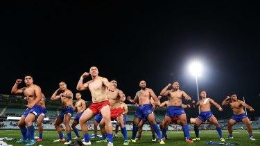 Great atmosphere: Samoa players perform the war dance Siva Tau during the Test against Tonga at Pirtek Stadium.