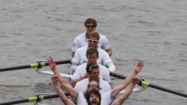 We won ... the Cambridge rowing team celebrates.