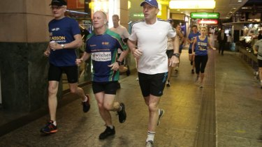 Tony Abbott goes out for an early morning run with Queensland Premier Campbell Newman, centre, in Brisbane on Saturday before flying out to Arnhem Land.