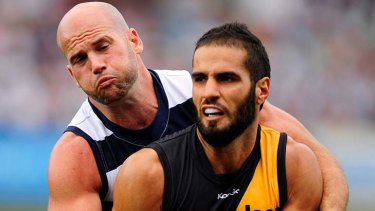 Bachar Houli, being tackled here by Geelong's Paul Chapman, has been enjoying another consistent season across half-back with a hardened defensive edge.