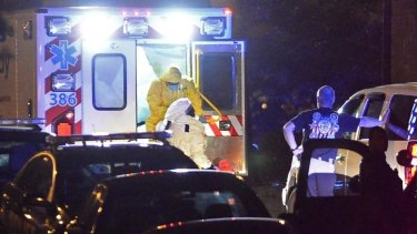 An ambulance carrying Amber Vinson, the second health care worker to be diagnosed with Ebola in Texas, arrives at Emory University Hospital in Atlanta.