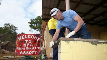 Prime Minister Tony Abbott assists in the community hall upgrade in the Injinoo community, Cape York.