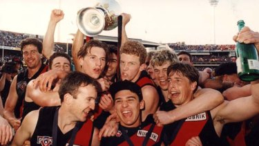 James Hird (fourth from right) and Mark Thompson, right celebrate winning the 1993 grand final with Essendon.