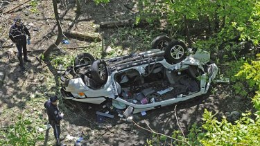 Seven dead ... the car plunged more than 50 feet.