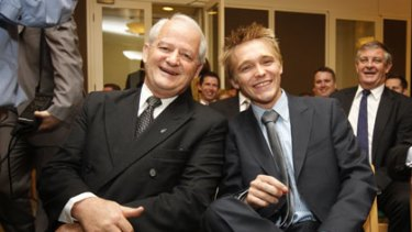 Up close and personal ... Philip Ruddock with the MP for Longman, Wyatt Roy, at  the   party meeting in Canberra yesterday.