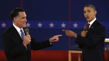 Former Massachusetts Gov. Mitt Romney and President Barack Obama spar during the second presidential debate in 2012.