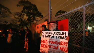 People gather at a vigil outside the Broadmeadows Detention Centre to try to halt the transfer of 20 asylum seekers to a detention camp on Nauru.