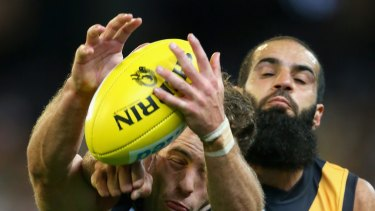 Bachar Houli, of the Tigers, and Jarryd Blair, of the Magpies, during Friday night's controversial game.