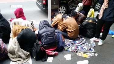 Queuers sleep on the Sydney street.