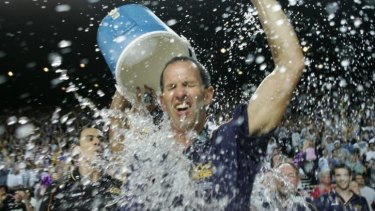 Brian Goorjian gets a soaking from CJ Bruton as the Kings celebrate the three peat in 2005.
