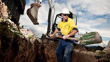 Workers construct the NBN in Tasmania.