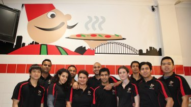 Owner Charlie Hoyek (centre) and his crew at Manoosh Lebanese Pizzeria.