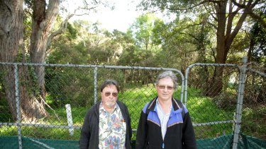 Gavin Gatenby and Paul Craven at the site of woodland about to be cleared for the WestConnex project.