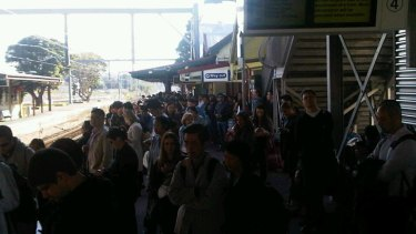 Delays ... passengers at Rockdale station this morning.