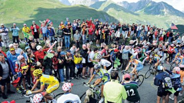 Go hard ...Alberto Contador, in yellow, and fellow competitors near the top of the Col du Petit St-Bernard.
