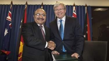 PNG's Prime Minister Peter O'Neill and Kevin Rudd shake hands over an asylum seeker deal on July 19.