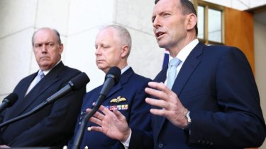 Defence Minister David Johnston (left) with Prime Minister Tony Abbott and chief of the Defence Force Air Chief Marshal Mark Binskin.