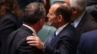 Prime Minister Tony Abbott pats Agriculture minister Barnaby Joyce after question time on Monday.