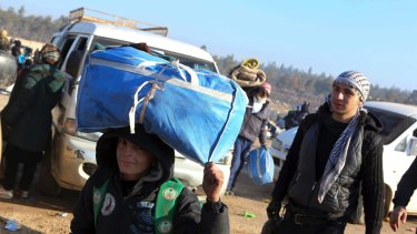A young boy is one of thousands evacuated from Aleppo on Monday.