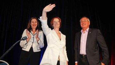 Prime Minister Julia Gillard, Queensland Labor leader Annastacia Palaszczuk (left) and Treasurer Wayne Swan (right) acknowledge the crowd at the Queensland Labor State Conference in Brisbane.