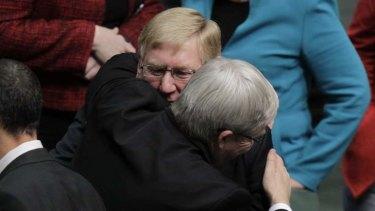 Kevin Rudd embraces former minister Martin Ferguson.