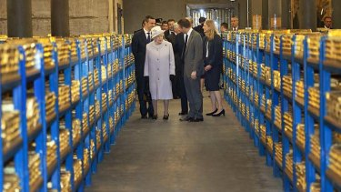 Worth a mint ... the Queen inspects a gold vault during a visit to the Bank of England.