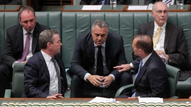 Commanding: Treasurer Joe Hockey, centre - with Prime Minister Tony Abbott, right - has emerged as the dominant figure in the new government.