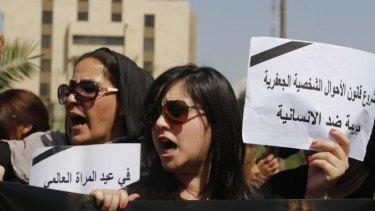 Opposed: Protesters demonstrate against the draft of the Al-Jafaari Personal Status Law in Baghdad.