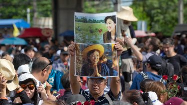 Supporters of Thailand's former Prime Minister Yingluck Shinawatra defy orders not to gather and mass outside the Supreme Court in Bangkok on Friday.
