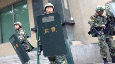 Chinese troop patrols on high alert in Urumqi, the capital of China's autonomous Xinjiang region.
