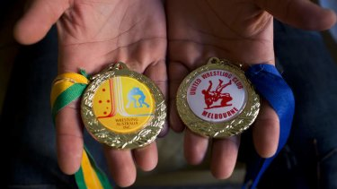 Heavy-weight champ: Two wrestling medals Arzhang has won since arriving in Australia.