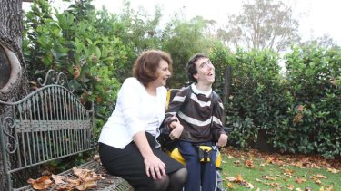 """The picture is just so gruesome"" ... Sue O'Reilly, with her son Shane who has cerebral palsy, says the system is in complete crisis."