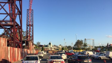 Police and emergency crews remain outside Dreamworld after the horrific accident on the Thunder River Rapids ride.