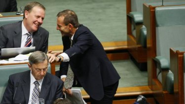 He's not the messiah ... Tony Abbott kneels  before Peter Costello who, he says, made the ultimate sacrifice for Malcolm Turnbull.