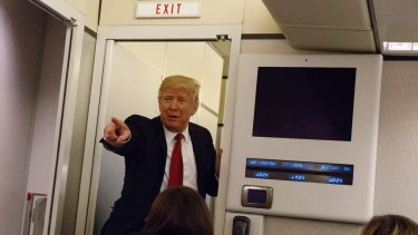 Obama did it: US President Donald Trump speaks to reporters aboard Air Force One before landing in Maryland last week.
