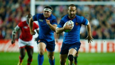 Confident: Frederic Michalak finds space during France's match against Canada.