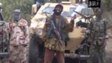 A grab from a video shows the leader of the Islamist extremist group Boko Haram Abubakar Shekau (centre) delivering a speech. Boko Haram is suspected of carrying out the latest Kano attack as it continues to target schools and kill and abduct students.