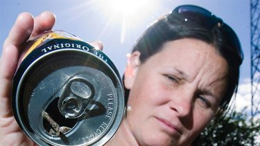 Linda Foster, of Casino, with the can of Bundaberg Rum which, she says, came with the mouse inside.