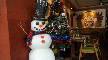 A Snowman at a local, empty restaurant in Ubud.