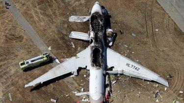 Ripped open: Flight 214 lies on the runway at San Francisco International Airport.