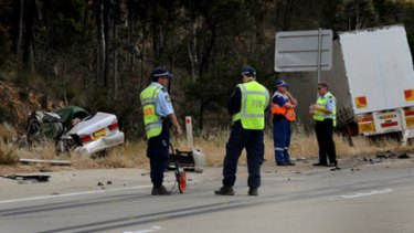 Head-on smash ...  four young men died when  their car collided with a truck near Yass.