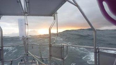 This picture, taken over the back of her boat  by Jessica Watson, shows the sun setting as she heads for Cape Horn.