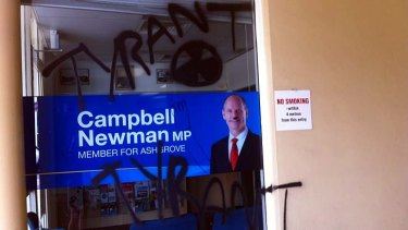 """Vandals have painted the word """"tyrant"""" and the radioactive symbol on Campbell Newman's electorate office window."""