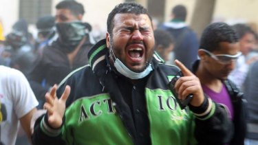 Unfinished business ... a protester screams in pain as tear-gas affects his eyes during clashes with police near Tahrir Square.