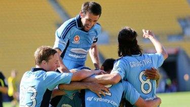 Winners ... Terry McFlynn of Sydney FC (top) celebrates the goal of Sebastian Ryall with team-mates.