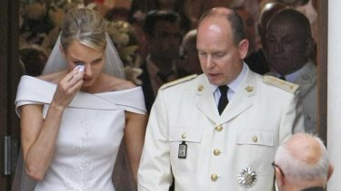 Princess Charlene wipes a tear after marrying Prince Albert of Monaco.